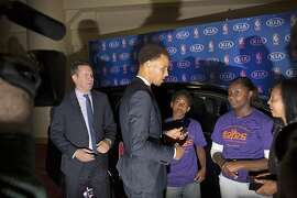 Stephen Curry donates a Kia to the East Oakland Youth Development Center after being presented with the NBA MVP trophy at the Oakland Convention Center in Oakland, Calif. on Monday, May 4, 2015.