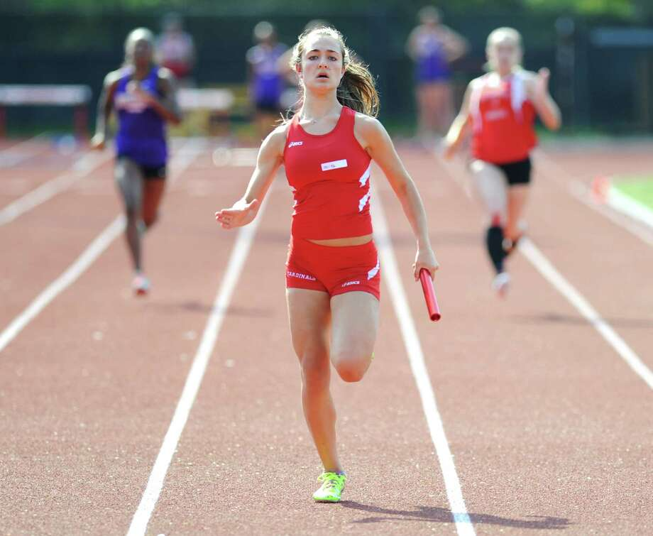 Greenwich's Anna Giannuzzi crosses the finish line first in the final leg of the 4x100 relay at the high school girls track meet between Greenwich, Westhill and Fairfield Warde at Greenwich High School in Greenwich, Conn. Monday, May 4, 2015. Photo: Tyler Sizemore / Greenwich Time