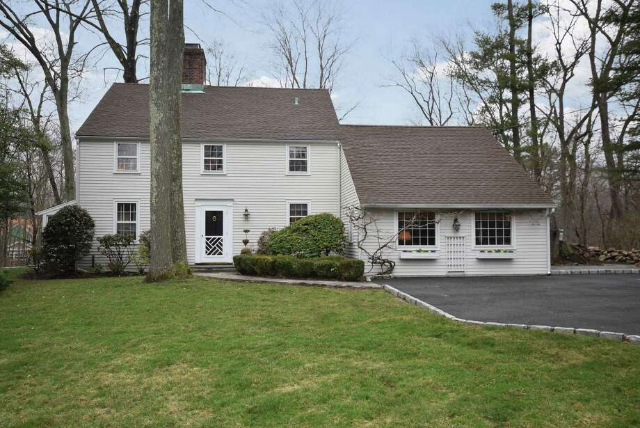The property at 9 Midbrook Lane, which sits on a large flat parcel of land (just under one acre ), offers plenty of privacy. Photo: Contributed Photo / Darien News