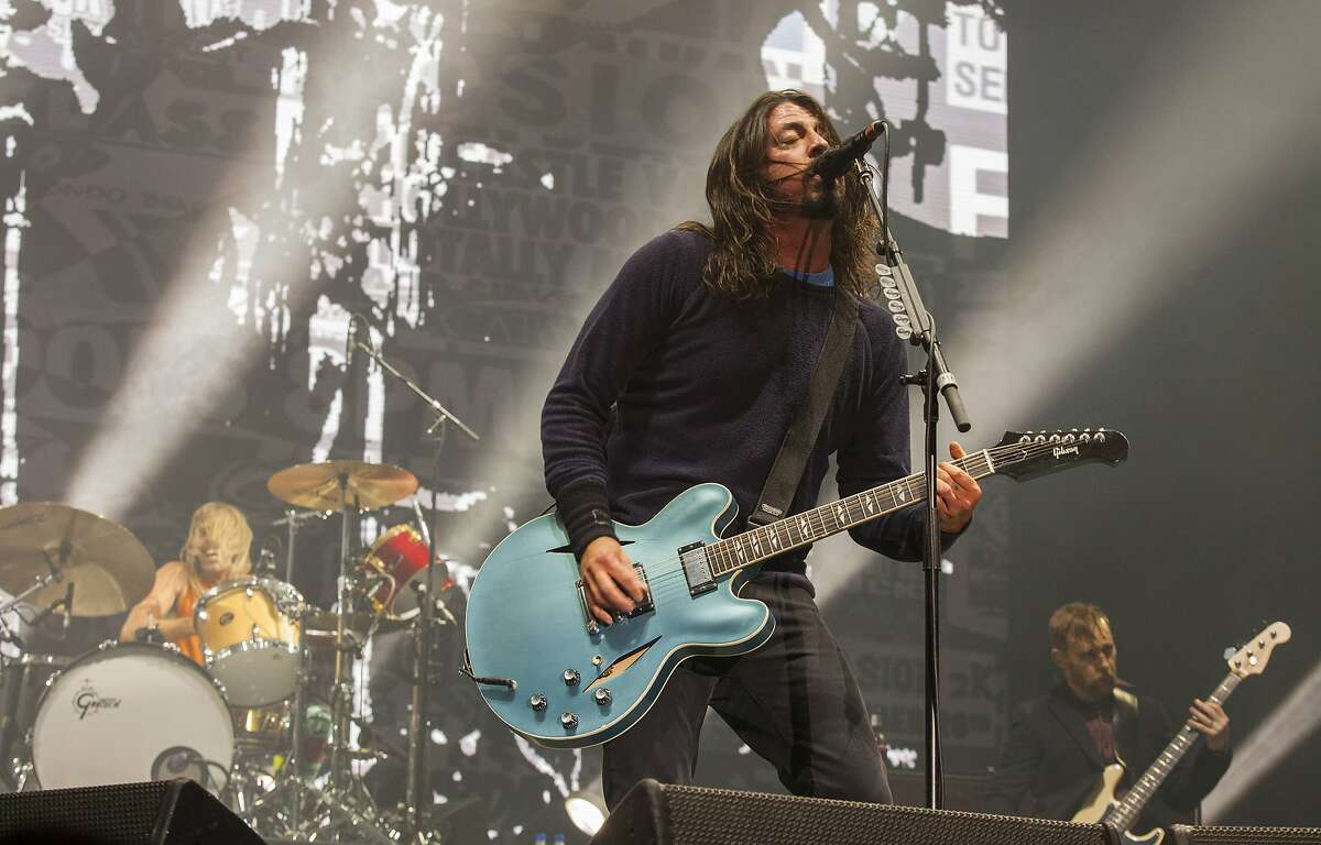 Taylor Hawkins, Dave Grohl and Nate Mendel of the Foo Fighters perform at the Voodoo Music Experience in New Orleans.