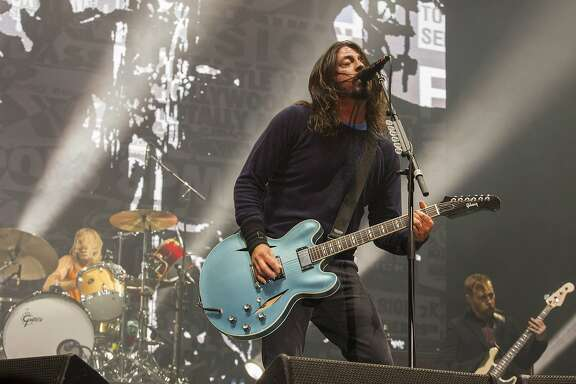FILE - In this Nov. 2, 2014 file photo, Taylor Hawkins, Dave Grohl and Nate Mendel of the Foo Fighters perform at the Voodoo Music Experience in New Orleans. The Rolling Stones, Foo Fighters and Iggy Azalea will play during an 11-day festival in Quebec City, Canada. Festival d'ete de Quebec will take place from July 9-19, 2015, and will include 300 shows across 10 venues (Photo by Barry Brecheisen/Invision/AP, File)
