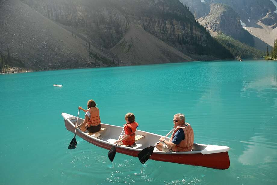 Late spring is an ideal time to canoe on uncrowded Moraine Lake. Photo: Crai S. Bower, Special To The Chronicle
