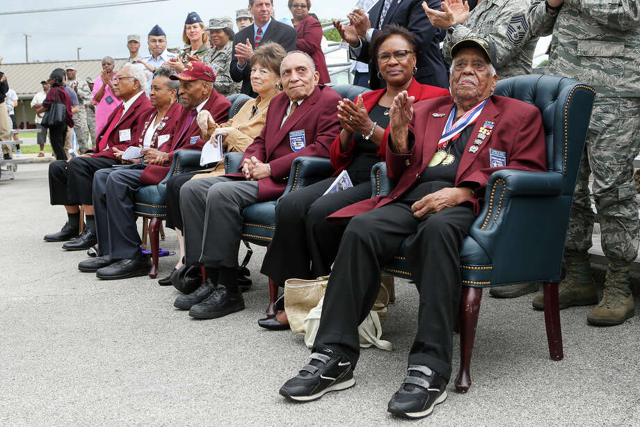 "Members of the Tuskegee Airmen and their families; Thomas Ellis (from right), Carolin Sinkfeild, wife of Lt. Col Rick Sinkfeild, Dr. Eugene Derricotte, Jeanne Derricotte, Dr. Granville Coggs, Dorothy Bynum and James Bynum, are recognized as Joint Base San Antonio-Lackland saluted the famed All-African American Air Force unit with a ceremony for the unveiling of the Tuskegee Airmen Exhibit in the U.S. Air Force Airman Heritage Museum & Enlisted Character Development Center at the base on Monday, May 4, 2015.  The new exhibit, in the museum's World War II gallery, features a three dimensional re-creation of a WWII ""Combat Maintenance Operations Room"".   MARVIN PFEIFFER/ mpfeiffer@express-news.net Photo: Marvin Pfeiffer, Staff / San Antonio Express-News / Express-News 2015"