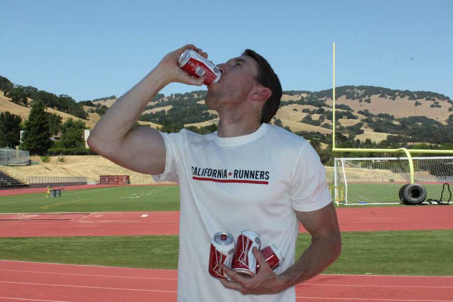 San Francisco native James Nielsen, 35, owns the world record for the beer mile, a race in which participants chug a 12-ounce beer before every lap of a one mile race. In August, the first ever Beer Mile World Classic, one of the few official beer mile events, will be coming to Pier 70 in San Francisco. Photo: Courtesy / James Nielsen / ONLINE_YES