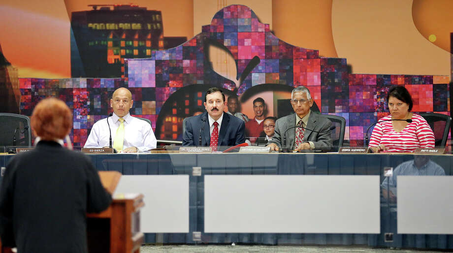SAISD board president Ed Garza (from left), deputy superintendent of instruction Matt Weber, and trustees Arthur Valdez, and Debra Guerrero listen to Henrietta La Grange speak against the hiring of Pedro Martinez as superintendent of schools Monday May 4, 2015 at the David G. Burnet Center. Photo: Edward A. Ornelas, Staff / San Antonio Express-News / © 2015 San Antonio Express-News