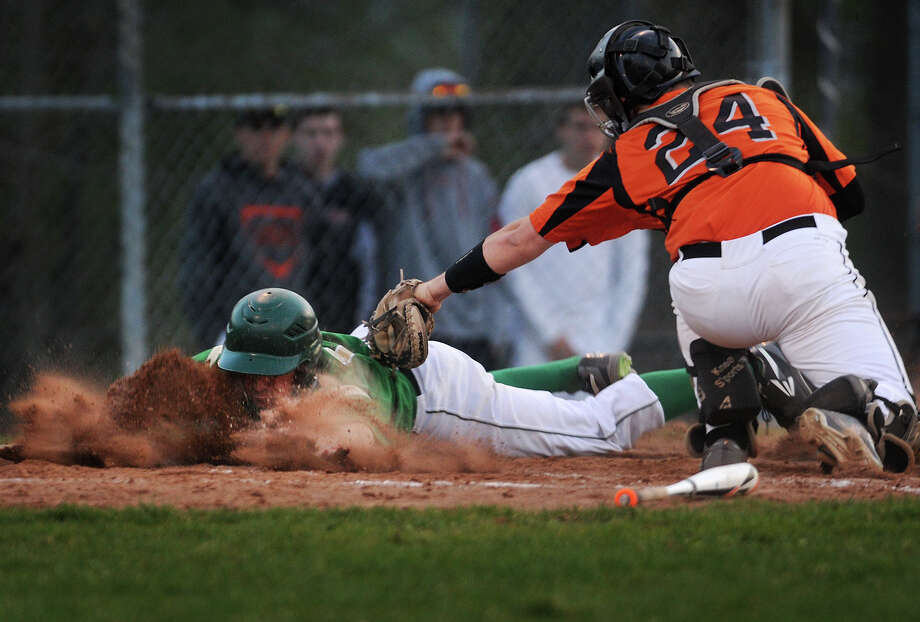 Notre Dame of West Haven's Dylan Reynolds is tagged out trying to score from third by Shelton catcher Marc Zoppi in the third inning of their game at Shelton High School in Shelton, Conn. on Monday, May 4, 2015. Photo: Brian A. Pounds / Connecticut Post