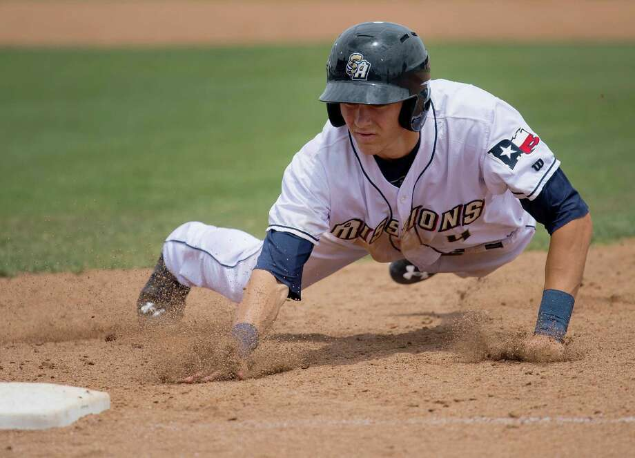 The Missions' Trea Turner dives back to first base to avoid being tagged out during a Texas League game against the Midland RockHounds on May 4, 2015, at Wolff Stadium in San Antonio. Midland won 4-3. Photo: Darren Abate /For The Express-News / San Antonio Express-News