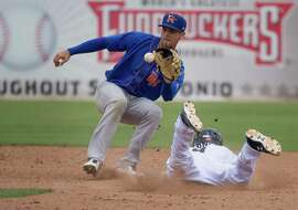 San Antonio Missions' Trea Turner is tagged out at second base by Midland Rockhounds shortstop Chad Pinder in the 11th inning of a Texas League baseball game against the Midland Rockhounds, Monday, May 4, 2015, at Nelson Wolff Municipal Stadium in San Antonio. Midland won 4-3. (Darren Abate/For the Express-News)