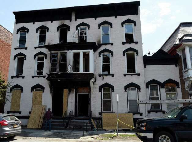The fire stricken structure at 518-520 Second Avenue is boarded up Monday morning May 4, 2015 at the Lansingburgh Boys and Girls in Troy, N.Y.   (Skip Dickstein/Times Union) Photo: SKIP DICKSTEIN / 00031689A