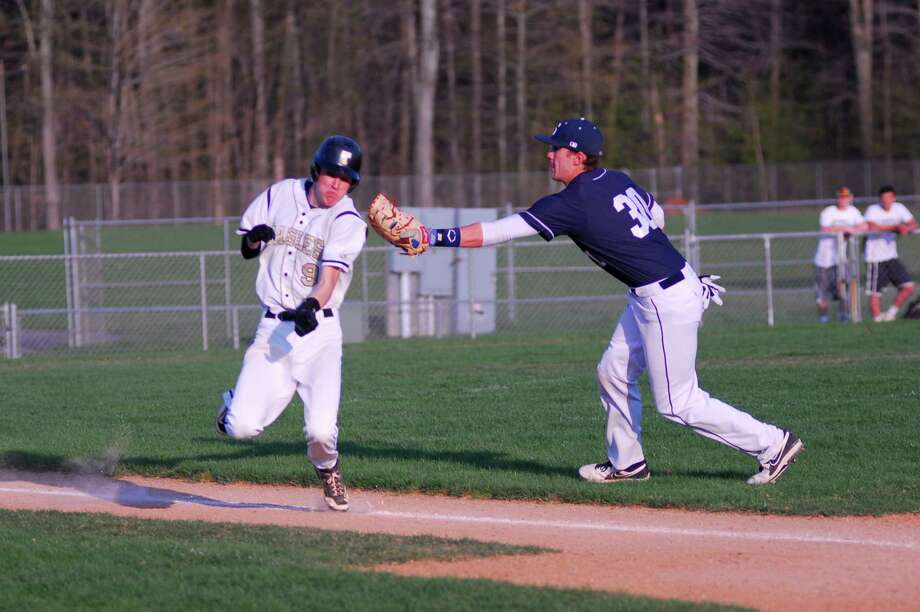 Staples first baseman Ross Poulley, right, tags Trumbull's Justin Waldek during a game on Monday. Trumbull won 2-0. Photo: Ryan Lacey/Staff Photo / Westport News Contributed