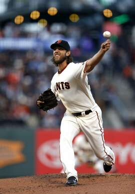 San Francisco Giants' Madison Bumgarner pitches in 1st inning against San Diego Padres during MLB game at AT&T Park in San Francisco, Calif., on Monday, May 4, 2015.