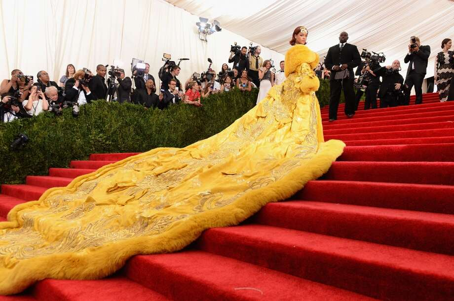 Rihanna. She knows how to make an entrance. Rihanna won the red carpet by taking full advantage of the Met steps with this golden Guo Pei gown and its everlasting train that took three guys to manage. It's also a dress that launched a thousand memes. Photo: Dimitrios Kambouris, Getty Images