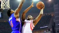 Houston Rockets forward Terrence Jones (6) goes up for a shot defended by Los Angeles Clippers center DeAndre Jordan, left, during the first quarter of Game 1 of the NBA Western Conference semifinals at Toyota Center Monday, May 4, 2015, in Houston. ( James Nielsen / Houston Chronicle )