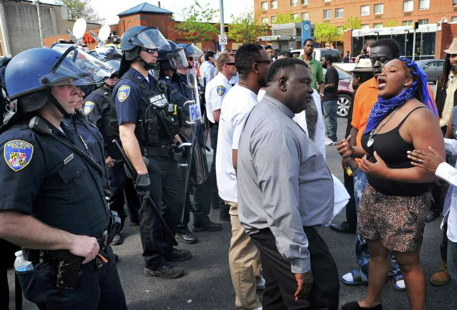 Protesters chant in front of police Monday  in Baltimore after police chased a man spotted on surveillance cameras who appeared to be armed with a handgun. The man was taken into custody. Photo: Amy Davis / Associated Press / The Baltimore Sun