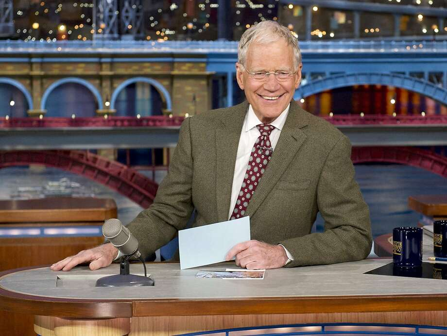 "FILE - In this April 3, 2014 file photo provided by CBS, David Letterman, host of the ""Late Show with David Letterman,"" smiles after announcing his retirement during a taping in New York. Letterman will host his final show on May 20. (AP Photo/CBS, Jeffrey R. Staab) MANDATORY CREDIT, NO SALES, NO ARCHIVE, FOR NORTH AMERICAN USE ONLY Photo: Jeffrey R. Staab, Associated Press"