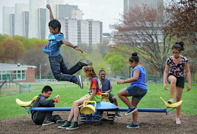 From left, Sa Nay, 11, Bae Reh, 10, Tori Smith-Wyld, 10, Douglas Brown lll, 10, Keke Lovelady, 11, and Andrea Federis, 12, of the Thomas O'Brien Academy of Science & Technology (TOAST) play on the school playground during recess on Monday, May 4, 2015 in Albany, N.Y. (Lori Van Buren / Times Union) Photo: Lori Van Buren