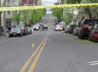 Several blocks of Lark Street in Albany remained closed Tuesday morning after an early morning shooting that reportedly left one person dead. At 7 a.m., dozens of police officrs remained on the scene and evidence markers could be seen at the intersection of Lark Street and Sheridan Avenue in the Sheridan Hollow section of the city. (Bob Gardinier / Times Union)