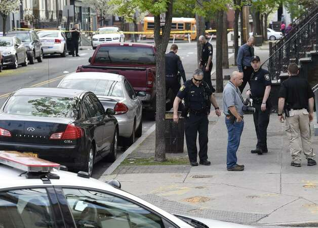Several blocks of Lark Street in Albany were closed Tuesday morning after an early morning shooting that reportedly left one person dead. At 7 a.m., dozens of police officrs remained on the scene and evidence markers could be seen at the intersection of Lark Street and Sheridan Avenue in the Sheridan Hollow section of the city. (Skip Dickstein / Times Union)