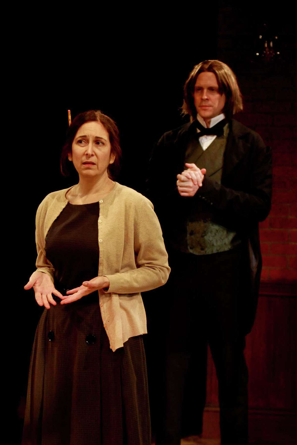 """Amy Herzberg stars as Rosemary Dunn and Justin Doran stars as Franz Liszt, in Stages' production of the play,""""The Spiritualist."""""""