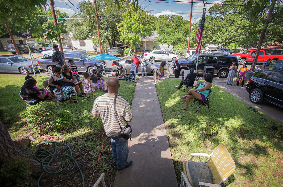 Family and friends gather to celebrate Richard Overton's 109th birthday in East Austin on Sunday, May, 3, 2015. Overton, is considered to be the oldest living World War II veteran in the United States. (Ricardo B. Brazziell/Austin American-Statesman via AP)