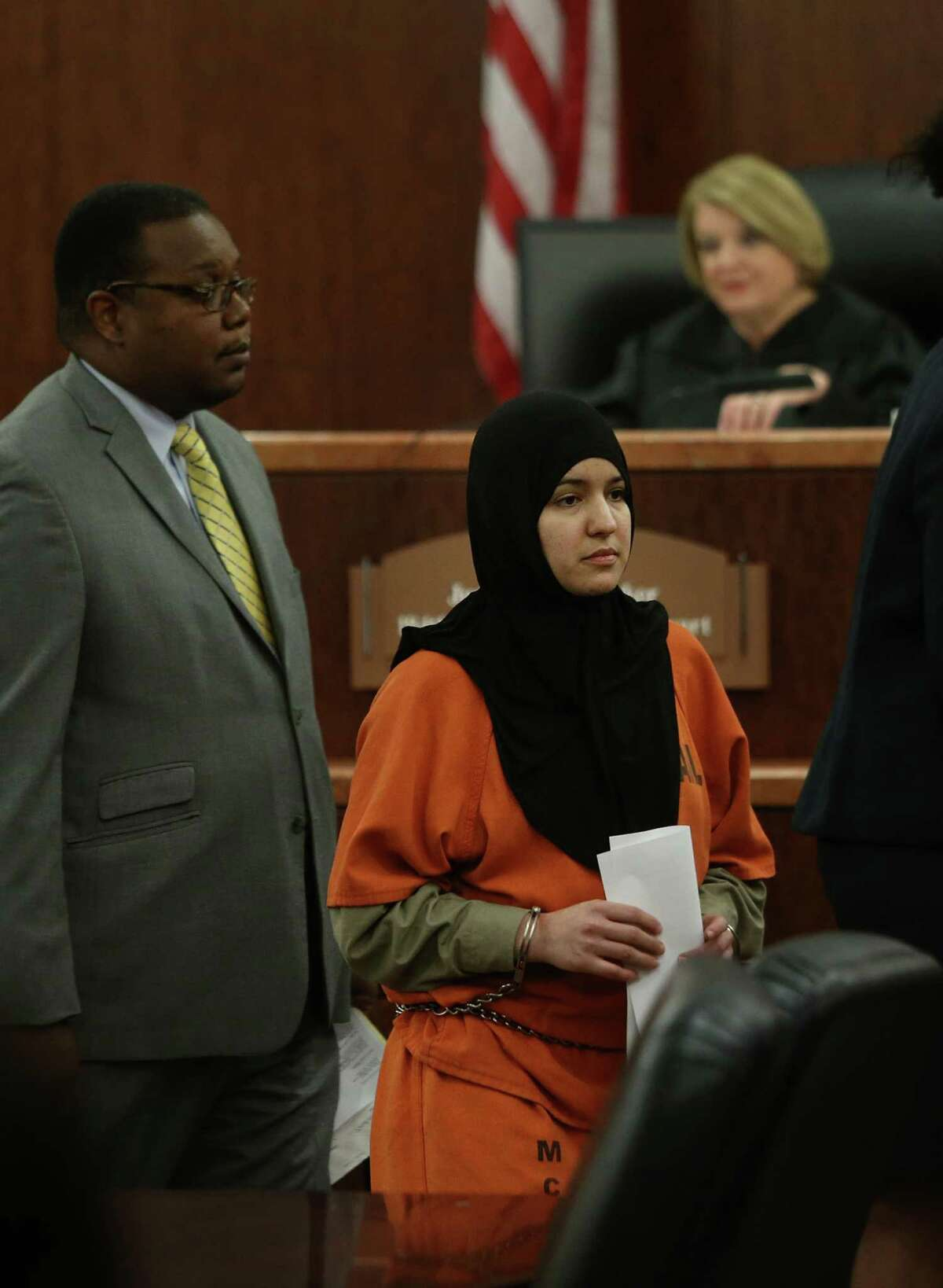 Nadia Irsan, who was accused of stalking her sister, her sister's husband, and her best friend, appears in the 184th State District Court at the Harris County Criminal Courthouse in 2015.