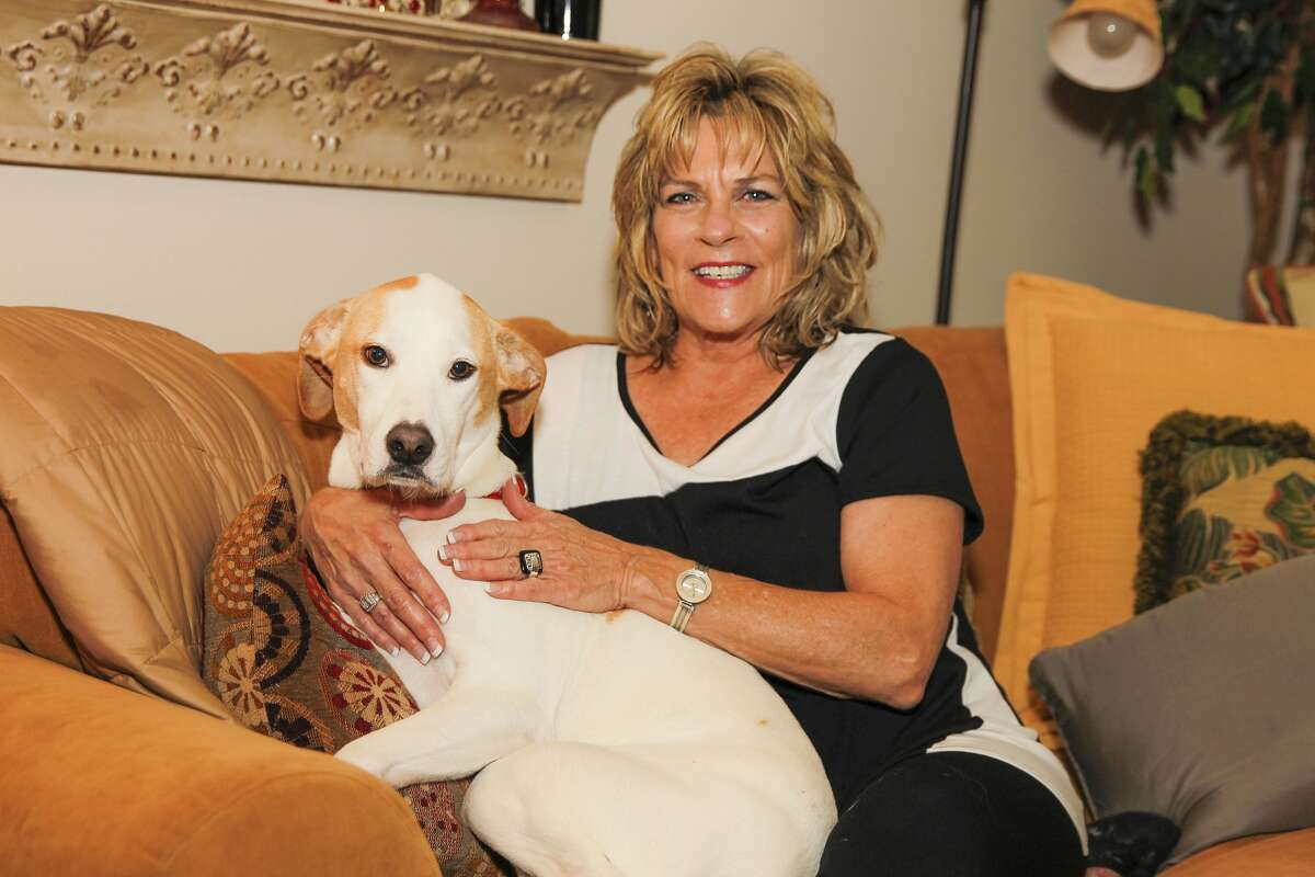 Anne Frye is this year's City of Katy Senior Citizen of the Year. She poses with her rescue dog Sadie at her home. Anne Frye is this year's City of Katy Senior Citizen of the Year. She poses with her rescue dog Sadie at her home.