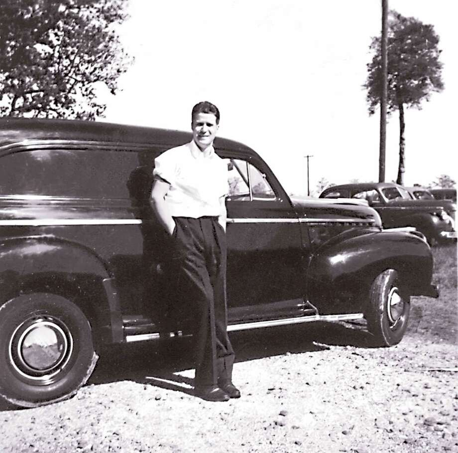 Thomas R. Shepard Jr. worked with Vick Chemical Co. in the early 1940s, driving this black panel truck to sell products to retailers.  Shepard, who died April 29 at age 96, was the former publisher of LOOK magazine. Photo: Contributed Photo / Greenwich Time Contributed