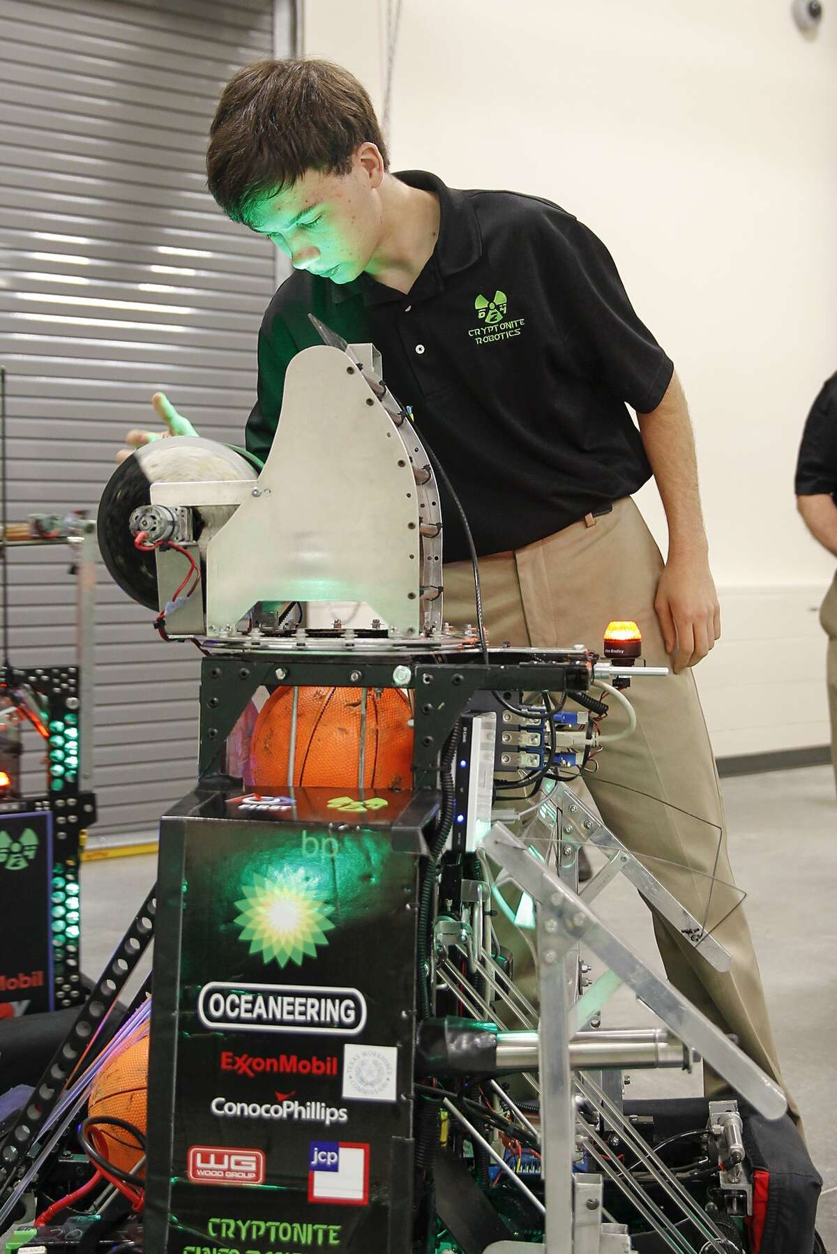 Cinco Ranch robotics student James Yoder makes adjustments to his team's robot during a demonstration at the dedication of the Katy ISD Robert R. Shaw Center for Science, Technology, Engineering, Art, and Mathematics or STEAM, on April 27, 2015.