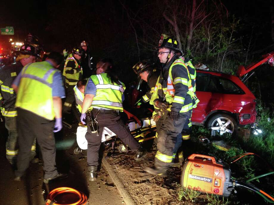 Firefighters and paramedics at the scene of a fatal accident on Interstate 95, between northbound Exits 22 and 23, early Tuesday. Photo: Fairfield Fire Department / Fairfield Citizen