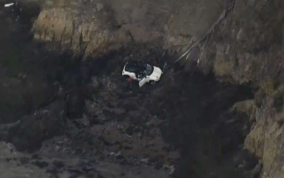 A Mini Cooper ended up at the bottom of a cliff Tuesday morning on Yerba Buena Island. Photo: CBS San Francisco
