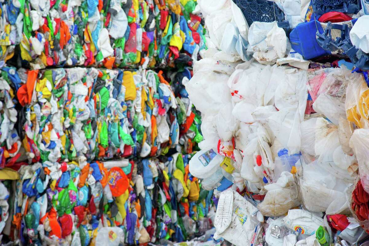 Bales of plastic that has been sorted and compressed at the Waste Management Recycling Facility Thursday November 20, 2014 in Southwest Houston, TX. (Billy Smith II / Houston Chronicle)