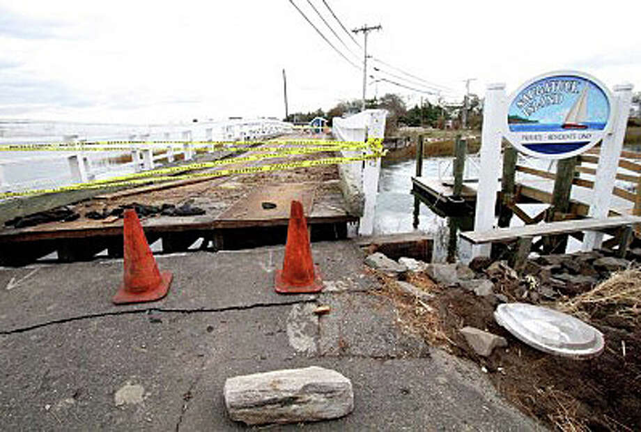 The damaged bridge to the Saugatuck Island community in the wake of Superstorm Sandy in 2012. Photo: Contributed Photo / Westport News