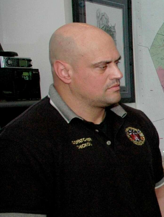 Jason Chickos, a Bridgeport resident and civilian dispatcher for the Newtown Police Department, is facing federal steroid and prescription distribution charges. Photo: The Newtown Bee