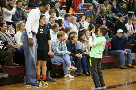 David Robinson poses for a photo with a Texas Military Institute fan prior to the TAPPS 4-4A game between San Antonio Christian and TMI at San Antonio Christian on Tuesday, Jan 13. Robinson's son Justin played for San Antonio Christian.