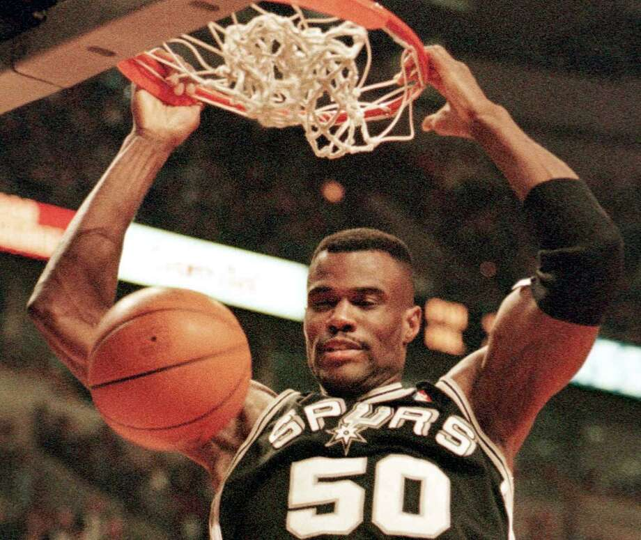 Spurs center David Robinson dunks the ball for two of his eight first half points against the Bulls on Feb. 25, 2000 at the United Center in Chicago Photo: John Zich /Getty Images / AFP