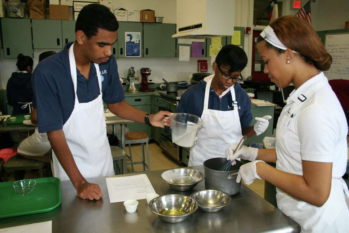 Lamar High School students Patrick Shelvin, left, Cherish Piper and Taylor Sutton work together making banana pudding. A partnership between Culinary Institute of America and Lamar and Davis high schools will allow students to earn credit toward attending the college. The institute also will offer advice on what equipment the schools should obtain when the campuses are rebuilt.