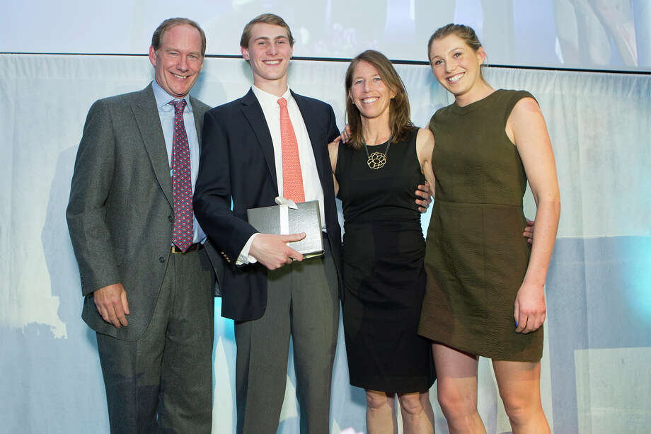 Rob, Nick, Kit and Katie Rohn of Darien accept a 2015 Red Apple Award during The Maritime Aquarium at Norwalkís Cirque de la Mer fund-raising gala on April 23. Photo: Kristen Jensen\Contributed Photo, Contributed Photo / Darien News