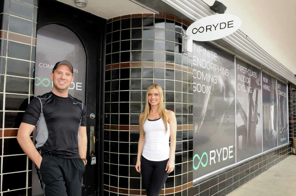 Andrew Pappas, left, and Ashley Gooch believe their new cycling fitness center has the right formula for spinners who live in the Inner Loop.