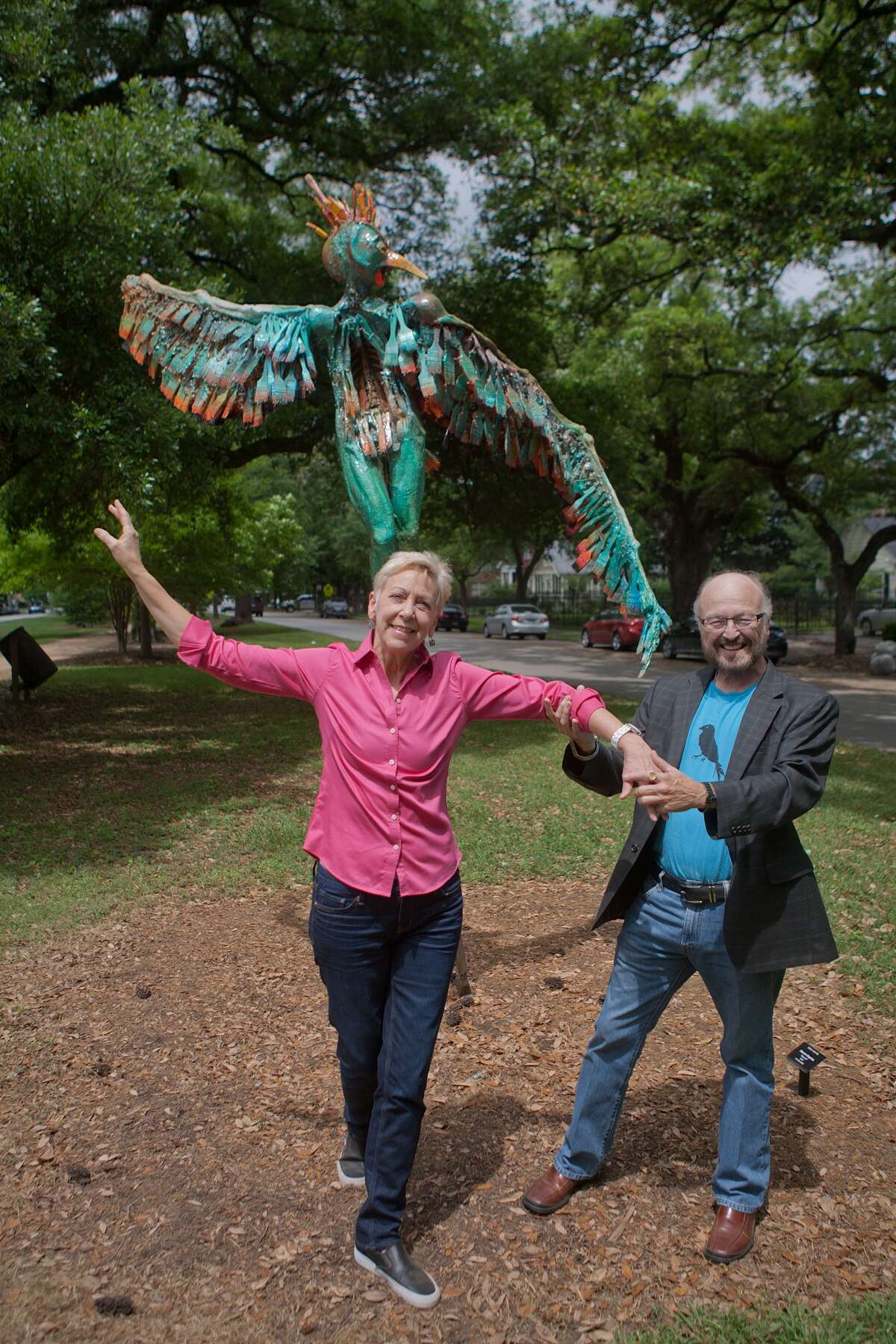 """""""True South"""" curators Chris Silkwood, left, and Gus Kopriva stand in front of Sharon Kopriva's """"Marcella,"""" a piece made in honor of Heights resident Marcella Perry and her love of dance."""