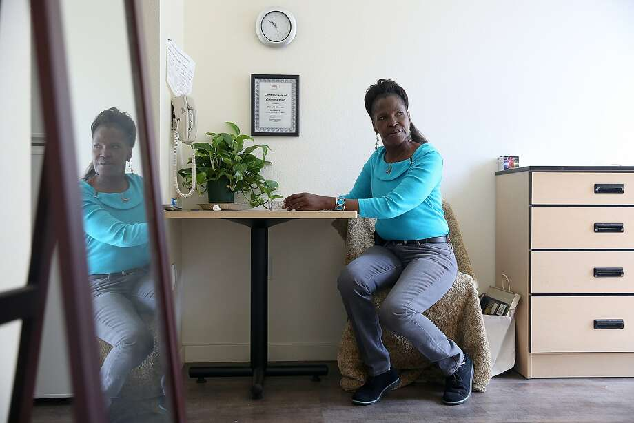Wanda Demus, 61, gets settled at home after returning from a recovery program last Friday in San Francisco, California, on Tuesday, May 5, 2015. Photo: Liz Hafalia, The Chronicle