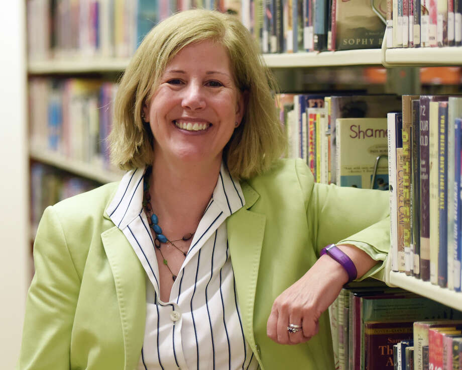 Ferguson Library President Alice Knapp poses inside the Ferguson Library in Stamford, Conn. Tuesday, April 28, 2015. Photo: Tyler Sizemore / Greenwich Time