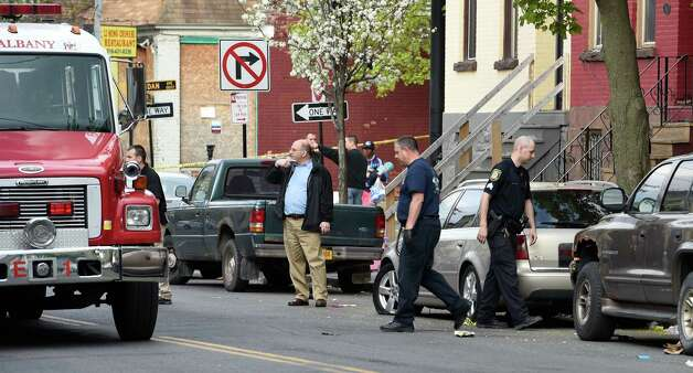 Albany Police investigate a murder early this morning at the shooting scene at 117 Lark Street Tuesday May 5, 2015 in Albany, N.Y.    (Skip Dickstein/Times Union) Photo: SKIP DICKSTEIN