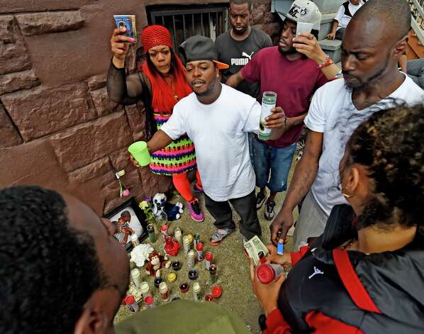 Friends of Courtney Yates, who was murdered early this morning in a multiple shooting, gather around a memorial near the shooting scene at 117 Lark Street Tuesday May 5, 2015 in Albany, N.Y.    (Skip Dickstein/Times Union) Photo: SKIP DICKSTEIN