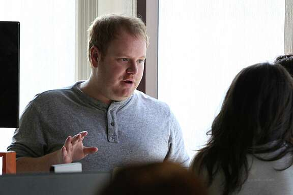 Zenefits CEO Parker Conrad talks with staff in his office in San Francisco, Calif., on Friday, November 7, 2014.
