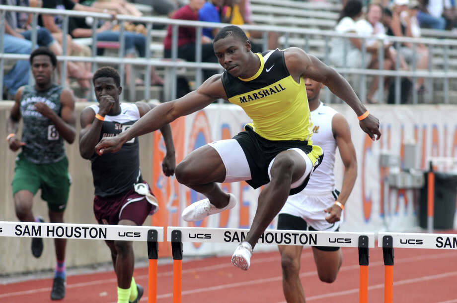 Fort Bend Marshall's Kendall Sheffield defended his crown in the 110-meter hurdles for the Buffs' powerful track team. Photo: Jerry Baker, Freelance