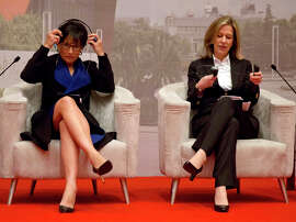 Commerce Secretary Penny Pritzker (left) and Deputy Energy Secretary Elizabeth Sherwood- Randall attend a discussion at the China Executive Leadership Academy Pudong in Shanghai.