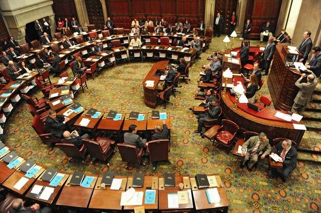 Members of the New York State Senate gather for session in the senate chamber at the Capitol on Monday, May 4, 2015 in Albany, N.Y. Senate Majority Leader Dean Skelos, the temporary president of the Senate, has been charged along with his son Adam in a six-count federal complaint. (Lori Van Buren / Times Union) Photo: Albany Times Union