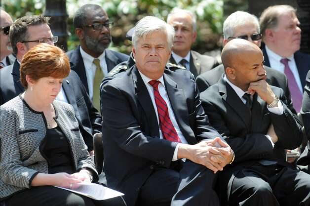 Senate Majority Leader Dean Skelos, center, joins Mayor Kathy Sheehan, left, and Assembly Speaker Carl Heastie, right, during a police officers memorial ceremony on Tuesday, May 5, 2015, at the State Police Memorial in Albany, N.Y. Nine officers, who died from line of duty injuries in 2014, were honored. (Cindy Schultz / Times Union) Photo: Albany Times Union