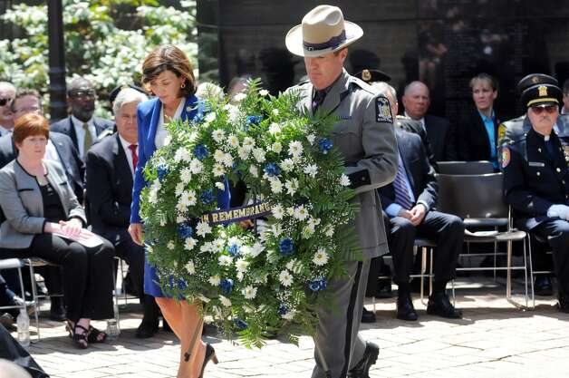 Lieutenant Governor Kathy Hochul, left, and Trooper William J. Gannon carry the wreath during a police officers memorial ceremony on Tuesday, May 5, 2015, at the State Police Memorial in Albany, N.Y. Nine officers, who died from line of duty injuries in 2014, were honored. (Cindy Schultz / Times Union) Photo: Albany Times Union