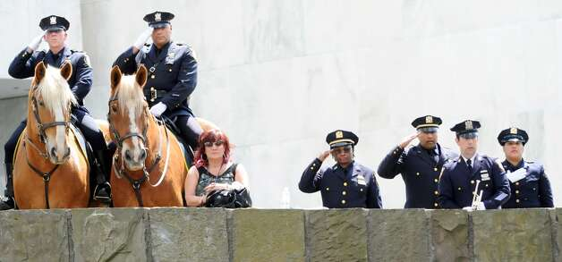 Police officers stand at attention during a police officer memorial ceremony on Tuesday, May 5, 2015, at the State Police Memorial in Albany, N.Y. Nine officers, who died from line of duty injuries in 2014, were honored. (Cindy Schultz / Times Union) Photo: Albany Times Union